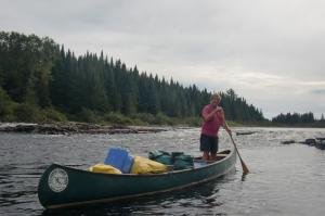 Chip-standing-in-canoe
