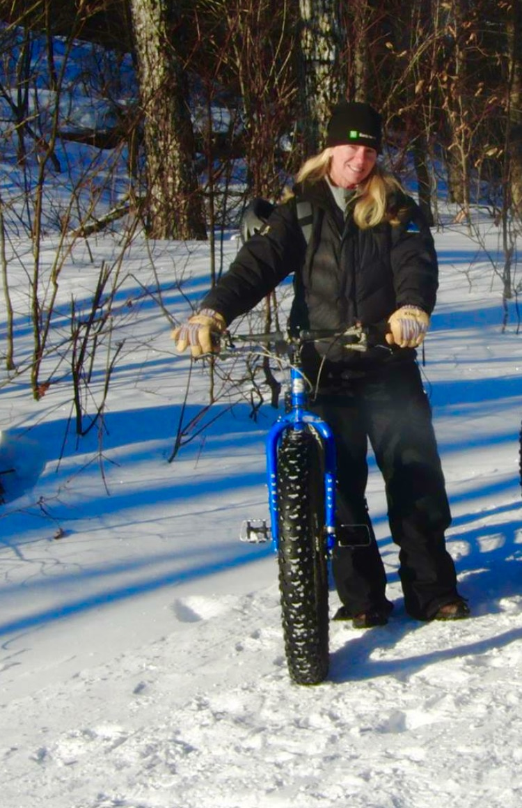 Lani Love guiding fat tire bike trip on Maine Huts & Trails